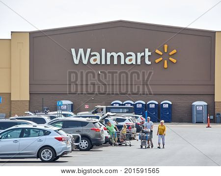 PLATTSBURGH USA - AUGUST 23 2017 : WalMart store and logo. Wal-Mart Stores Inc. doing business as Walmart is an American multinational retailing corporation that operates as a chain of hypermarkets