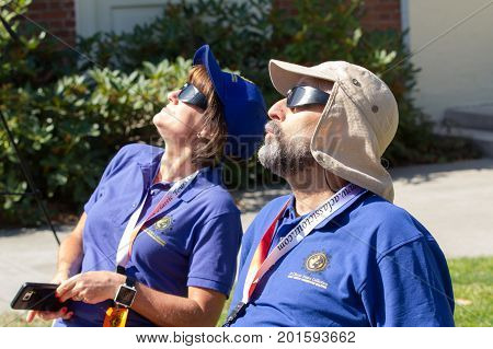 SALEM, WASHINGTON, USA - AUGUST 21, 2017: Eclipse enthusist  relax in their chairs while viewing the solar eclipse through special safety glasses