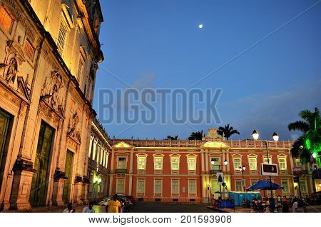 Salvador, Bahia, Brazil - December 22, 2015: Largo terreiro de Jesus. View of the Basilica Cathedral on the left side and the front the old Jesuit College of Salvador, now the medical school of Bahia.