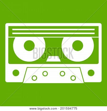 Audio cassette tape icon white isolated on green background. Vector illustration