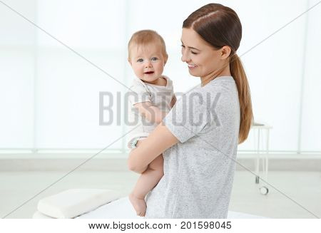 Young mother and baby girl in doctor's office