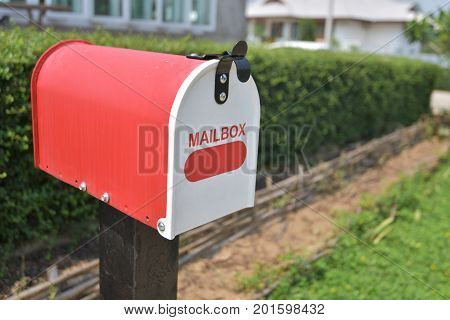 Home office red Metal Mailbox in garden.