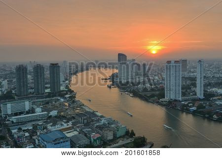 Bangkok city at sunset.Bangkok City at night time Hotel and resident area in the capital of Thailand.City scapes in bangkok.