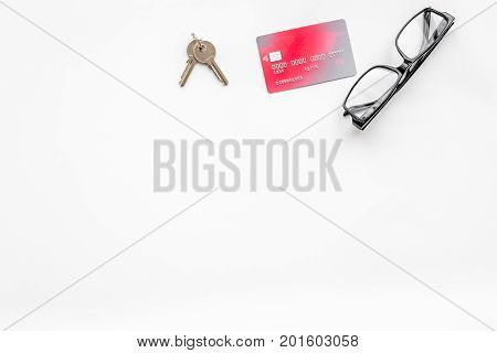 selling property online set with credit card on office desk white background top view mockup