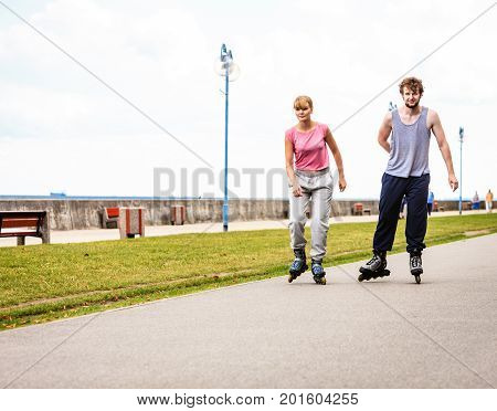 Active Young People Friends Rollerskating.