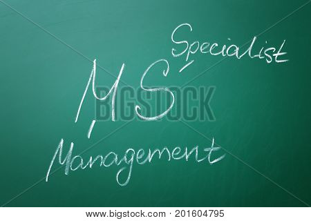Management abbreviation MS with its full form written on chalk board