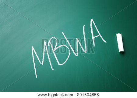 Management abbreviation MBWA written on chalk board