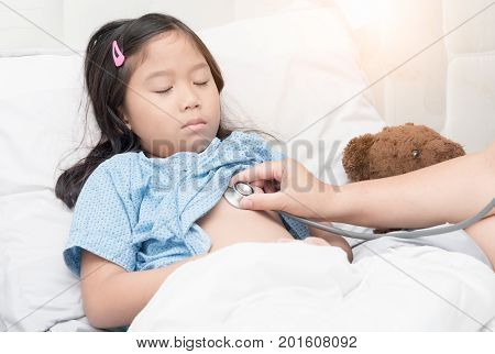 Doctor examining child patient with stethoscope in hospital. child health concept