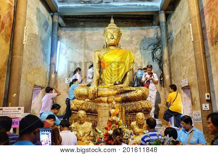 Samut Sakhon, Thailand - August 12, 2016: Buddha statue church old brick wall and tree root in Wat Bang Kung Samut Sakhon Thailand.
