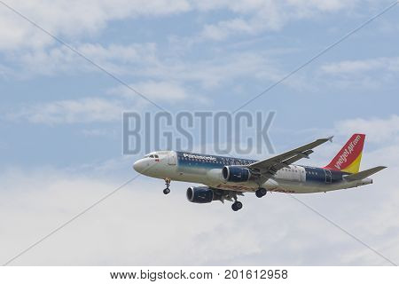 BANGKOK THAILAND - JUNE152017 : vietjet air plane approaching for landing to suvarnabhumi airport vietjet air is the first one of citizen business airline of vietnamese