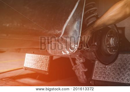 Car Lifted In Automobile Service For Fixing, Repair, Changing Disc Brake In Garage