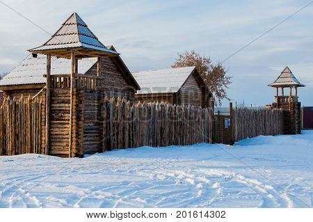 old wooden Fort, a stockade. winter near the lake