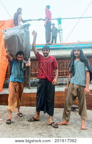 Hard Working Dockers In Traditional Dhow Wharfage Port