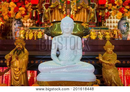 White Buddha Statue In Chinese Temple