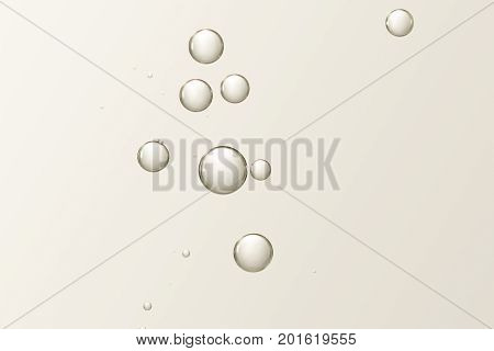 Beautiful light brown air fizz bubbles over a blurred background