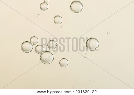 Beautiful golden shiny fizz bubbles over blurred background