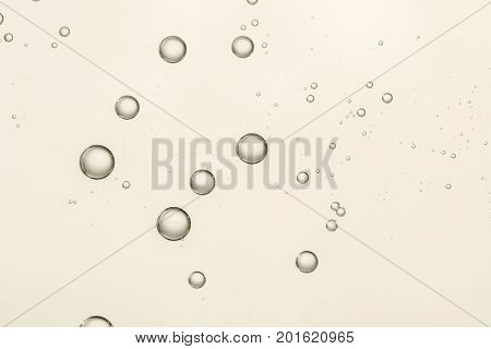 Beautiful golden champagne fizz over a blurred background