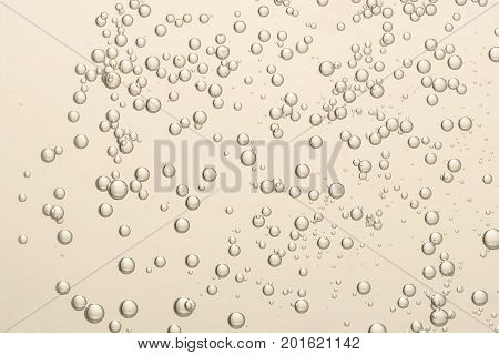 Many small fizz bubbles isolated over a blurred background