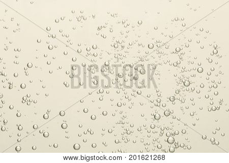 Beautiful shiny silver wine fizz bubbles over a blurred background