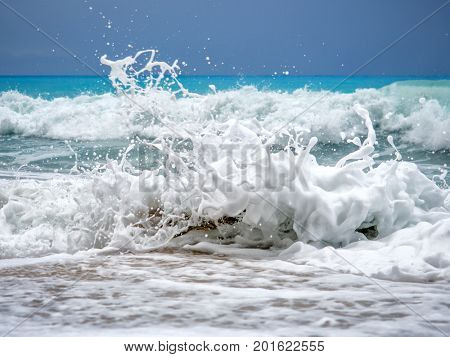 Blue wave in tropical ocean. Wave barrel crashing and clear water.