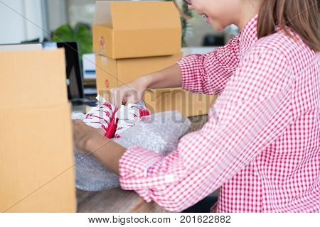 Start Up Small Business Owner Packing Shoes In The Box At Workplace. Freelance Woman Entrepreneur Sm