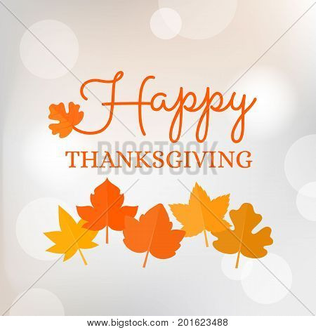 happy thanksgiving typographic headline with maple leave on bokeh background for poster or banner