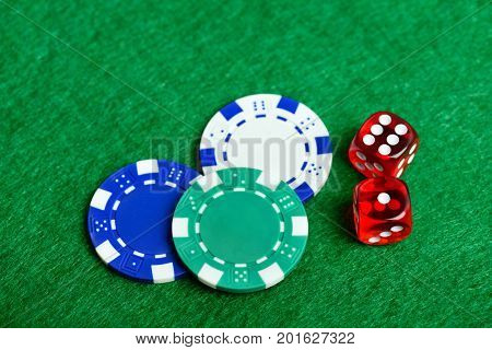 Casino green table with chips and dices. Poker game concept