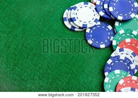 Casino background and chips, poker chips on a green table. Poker game concept