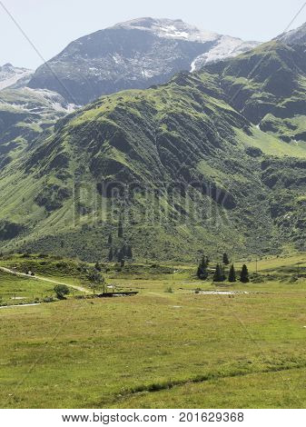 Alpine massif, beautiful Alpine canyon in Austria. Alpine Gastein Valley in summer. Mountains and pastures. Fresh air and healthy virgin nature. Excursional destination for hiking, vacation.