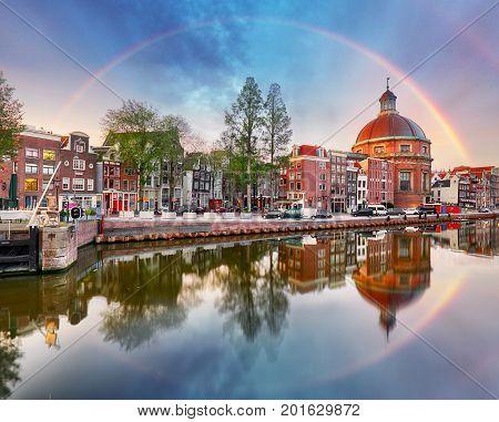 Rainbow over Amsterdam church Koepelkerk in Netherlands