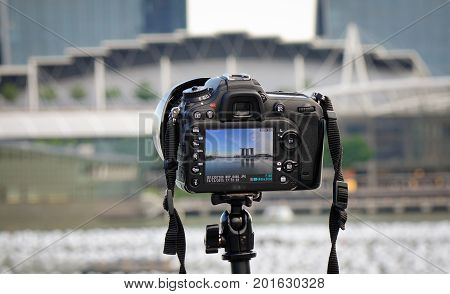 Dslr Camera On Waterfront In Singapore