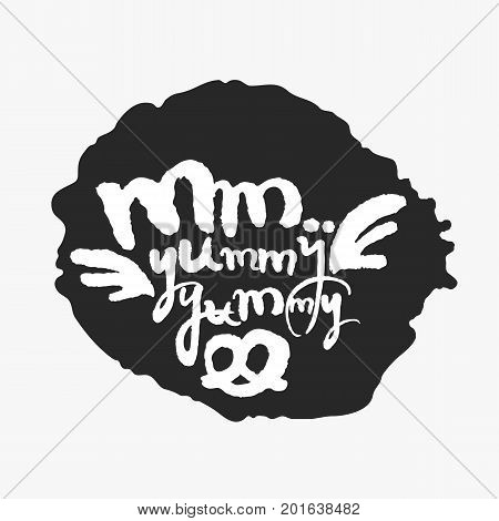 Mm Yummy Yummy. Hand written calligraphy phrase in an ink blot. White on black. Clipping paths included.