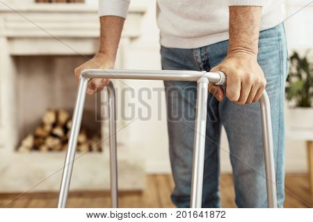 Walking aid. Close up of a professional walker being used by a pleasant good looking aged man