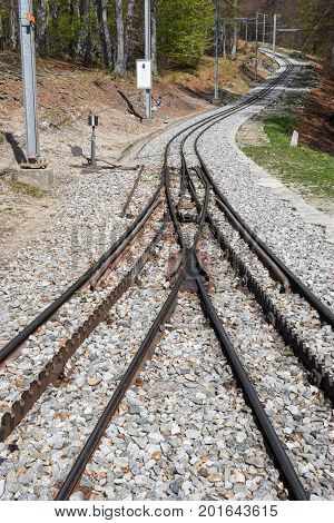 Monte Generoso Switzerland - 8 April 2017: Rack train rails of mount Generoso on the italian part of Switzerland