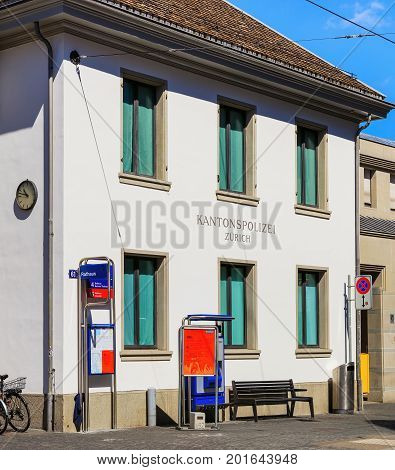 Zurich, Switzerland - 18 June, 2017: facade of the Rathaus police station, view from the Limmatquai quay. The Rathaus police station is located at the town hall of Zurich, the building has been used as a police station since 1798.