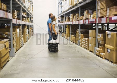 Young pregnant couple in diy store. Repair building renovation and home concept