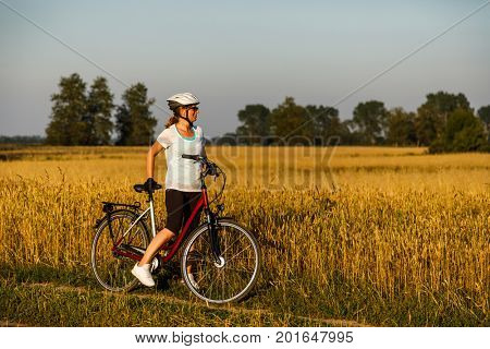 Woman riding bicycle in countryside