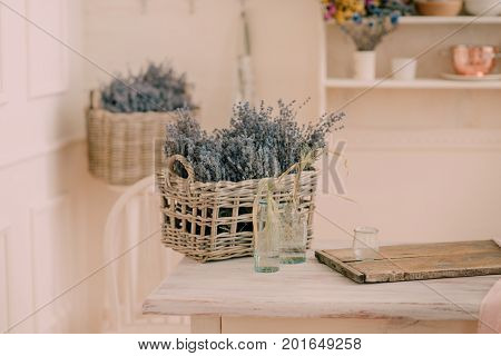 basket with lavender on a white wooden table
