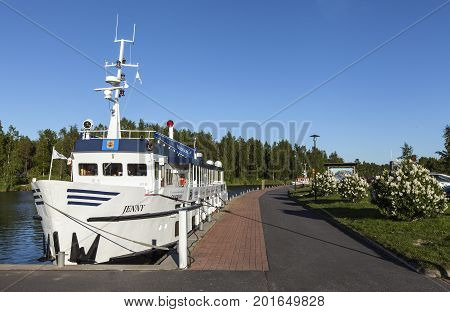 KOKKOLA, FINLAND ON JULY 07. View of M/S Jenny moored by the port on July 07, 2017 in Kokkola, Finland. Channel, sidewalk and bushes in the surrounding. Editorial use.