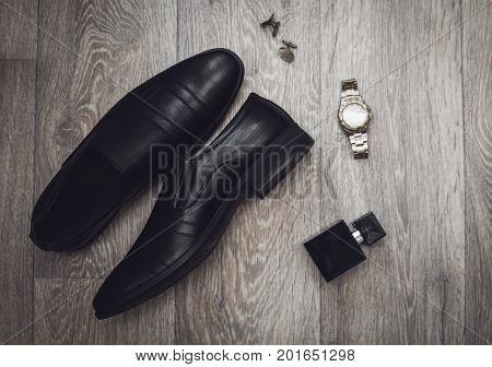 Businessman accessories. Man's style. Shoes with perfume