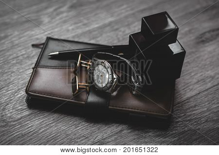 Businessman accessories. Man's style. Perfume with watch and notepad