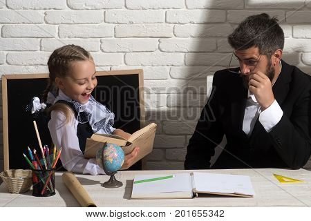 Daughter And Father In Classroom On White Brick Background