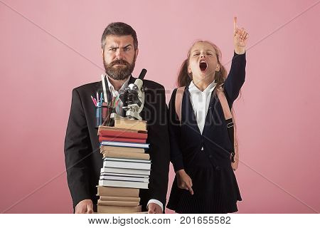 Kid And Dad Hold Pile Of Books And School Supplies