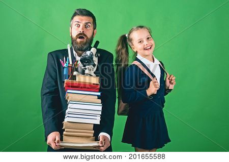Home Schooling And Back To School Concept. Father And Schoolgirl