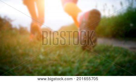 Blurred picture from below of two running women in forest