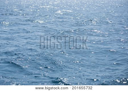 Sea or ocean blue water. Seascape natural water wallpaper. Travel vacation and sea voyage concept. Abstract marine background.