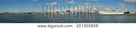 Klaipeda, Lithuania - August 20, 2017: Beautiful view on Klaipeda and Curonian Lagoon from The Curonian Spit, Lithuania. Beautiful summer panorama on Klaipeda, Curonian Lagoon and big cruise ship.