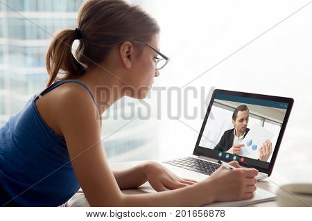 Business long distance video call, businessman and businesswoman discussing financial report using videoconference application for virtual communication, online meeting with videochat app, side view