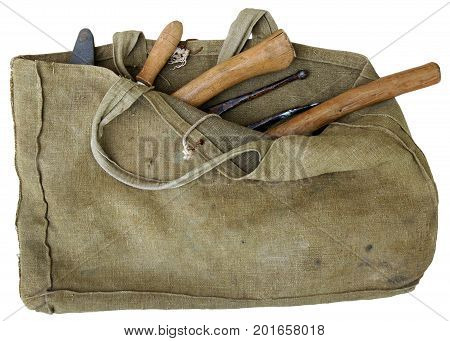 An old tarpaulin canvas bag for vintage tools isolated on white background
