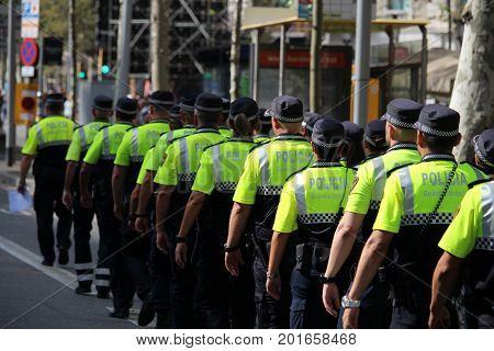 BARCELONA/SPAIN - 26 AUGUST 2017: Spanish police participating in the protest with over 500.000 participants against terrorism after attack on Barcelona`s Rambla.